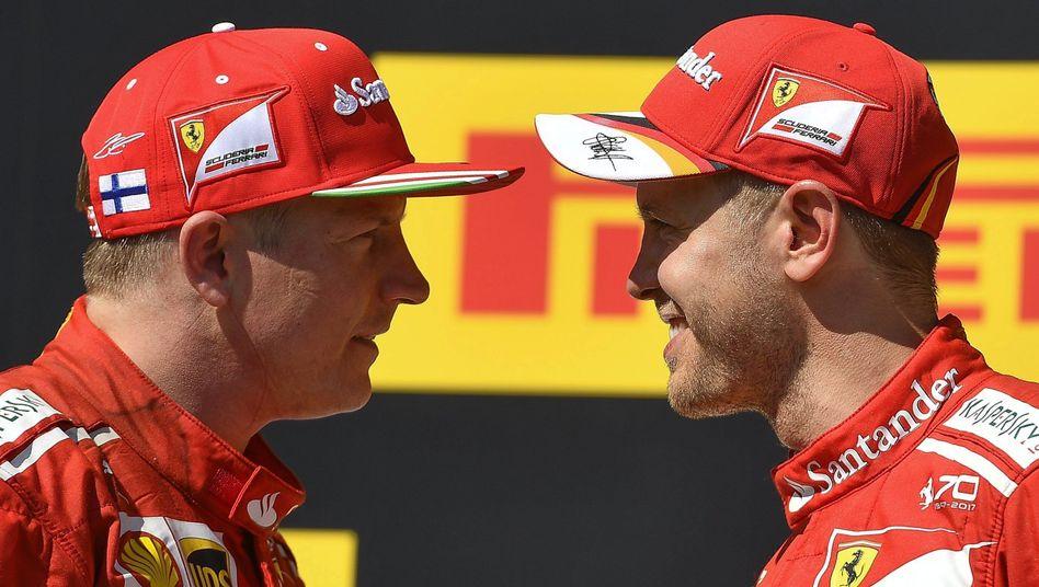 Kimi Räikkönen (l.), Sebastian Vettel