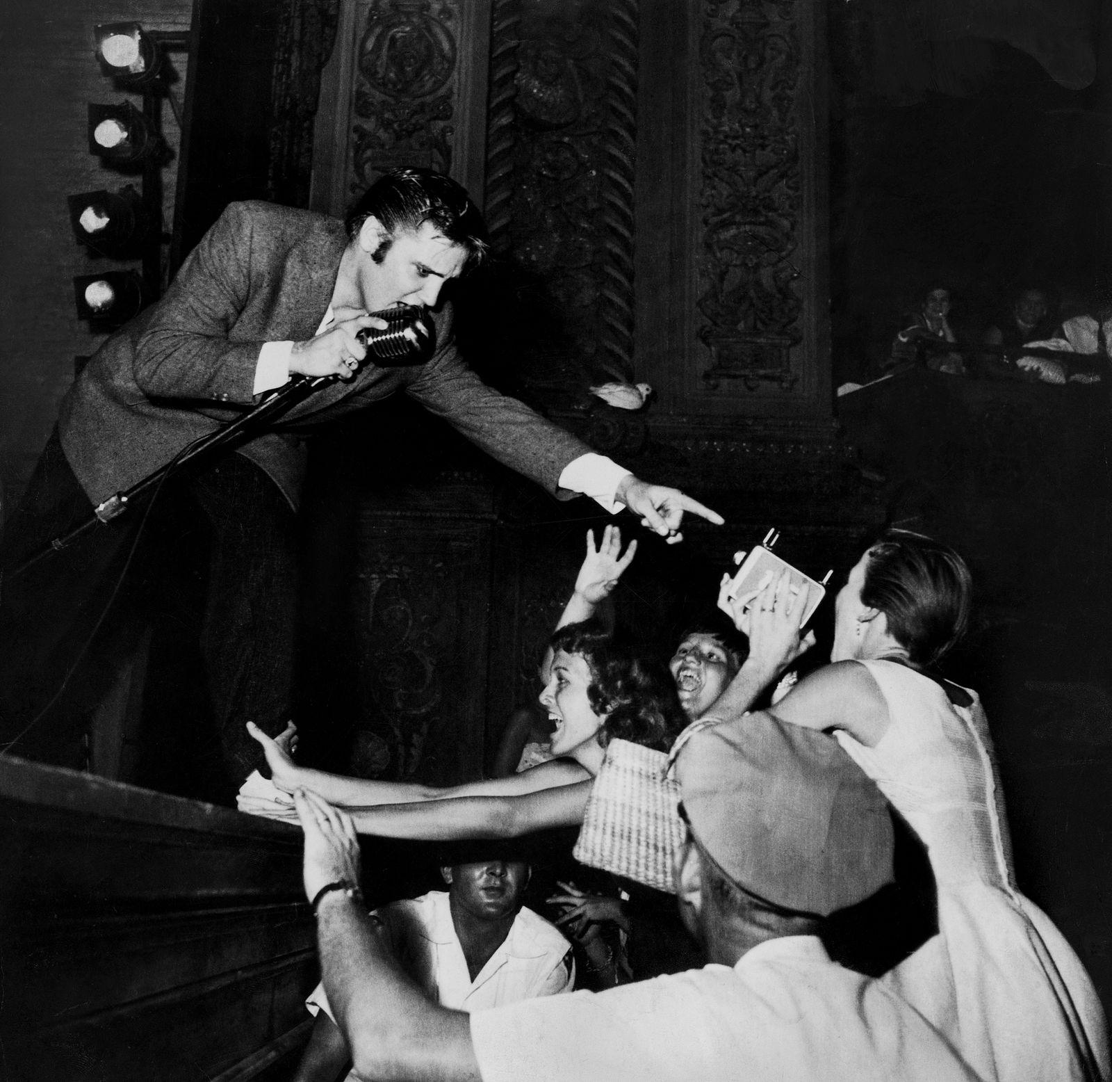 Singer Elvis Presley singing