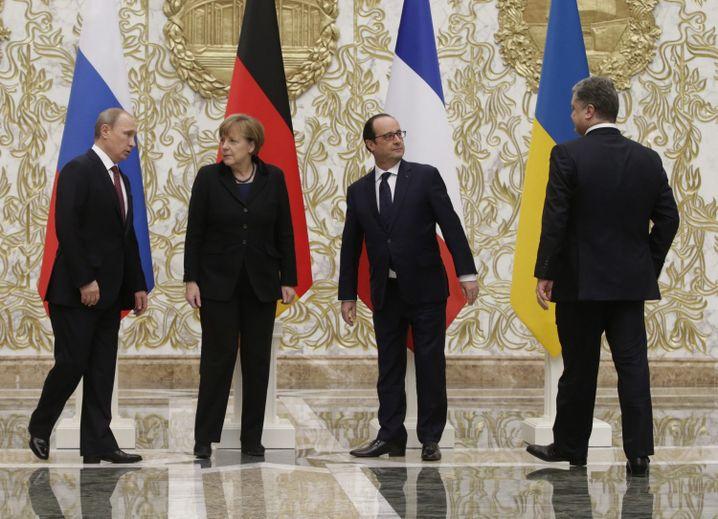 Putin mit Merkel, Hollande (Zweiter von rechts) und Petro Poroschenko (rechts)