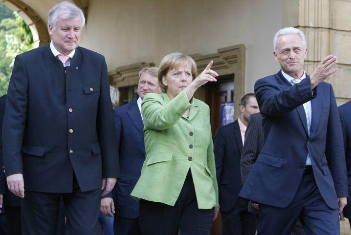 """Bayerns Ministerpräsident Seehofer, Bundeskanzlerin Merkel und CSU-Landesgruppen-Chef Ramsauer: """"Schwierige Fragen"""""""