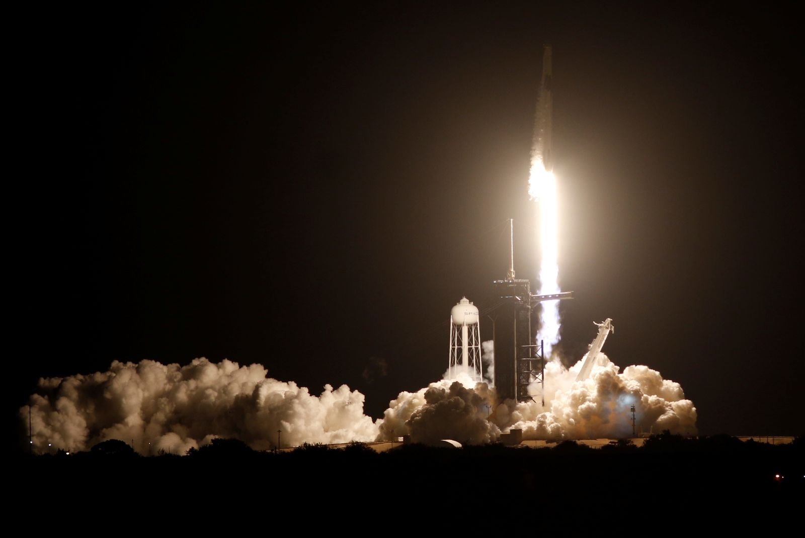 A SpaceX Falcon 9 rocket, with the Crew Dragon capsule, is launched carrying four astronauts on the first operational NASA commercial crew mission at Kennedy Space Center in Cape Canaveral, Florida