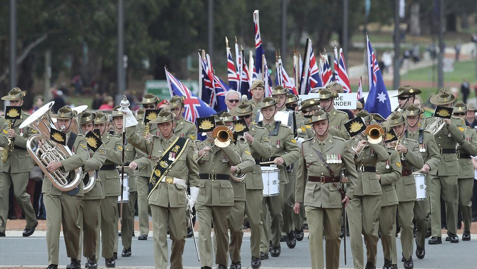 A military band marches onto the parade ground on Anzac Day at the Australian War Memorial in Canberra on April 25, 2014.