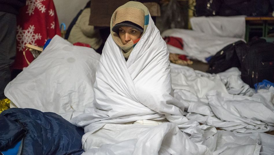 A Syrian refugee waits in a heated tent in the town of Hanging, Austria, as she waits for further transport to Germany on Nov. 3.