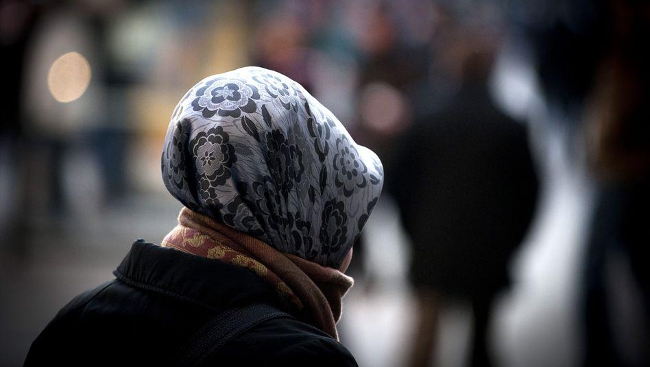 Frau mit Kopftuch: Auf dem Arbeitsmarkt oft mit wenig Chancen