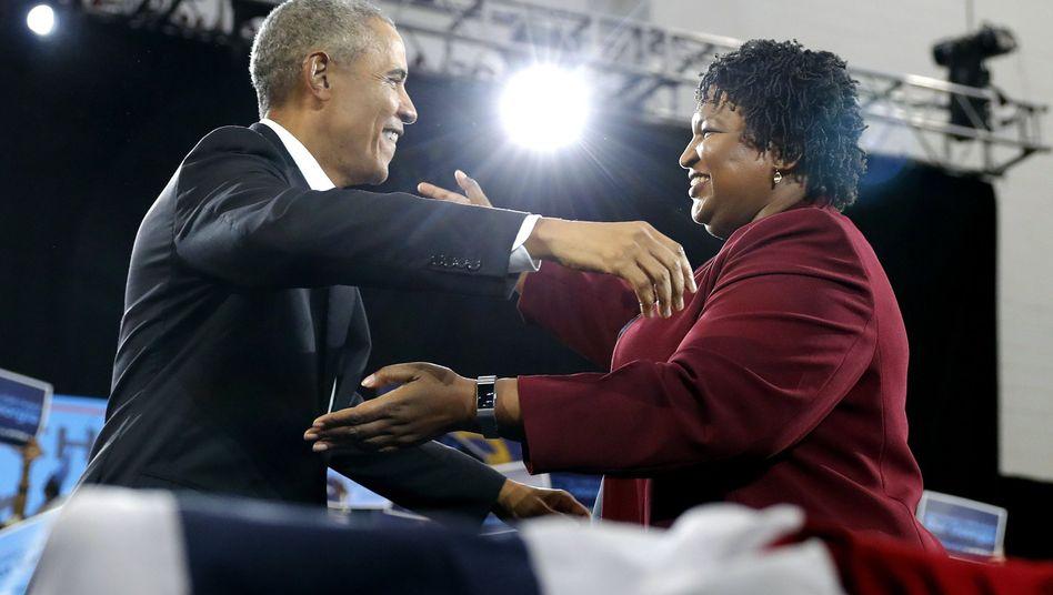 Abrams (r.), Obama