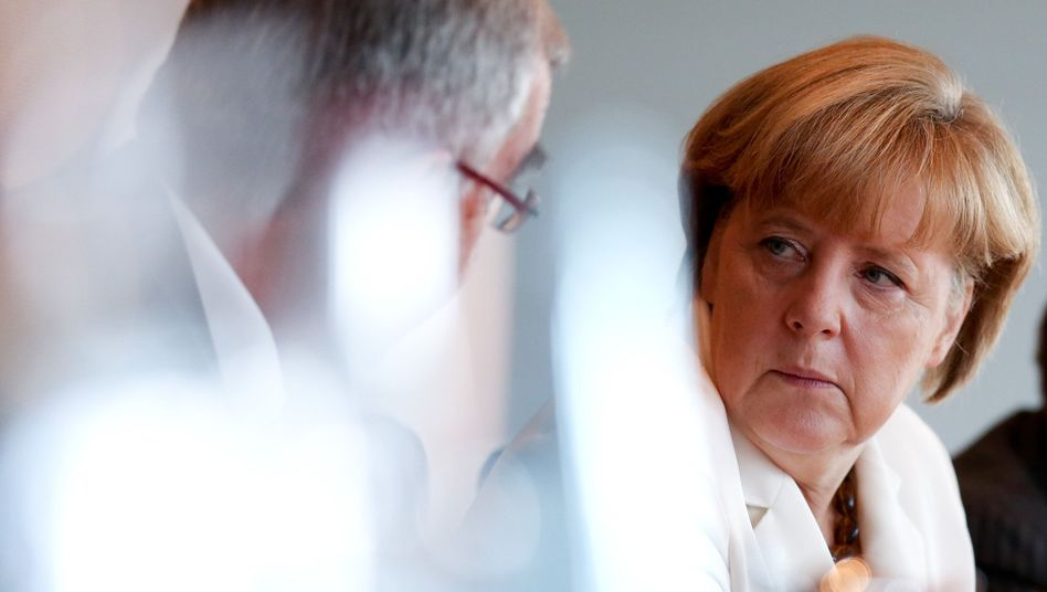 Chancellor Merkel dismissed comparisons between current surveillance practices and East Germany's Stasi in an interview with weekly Die Zeit.