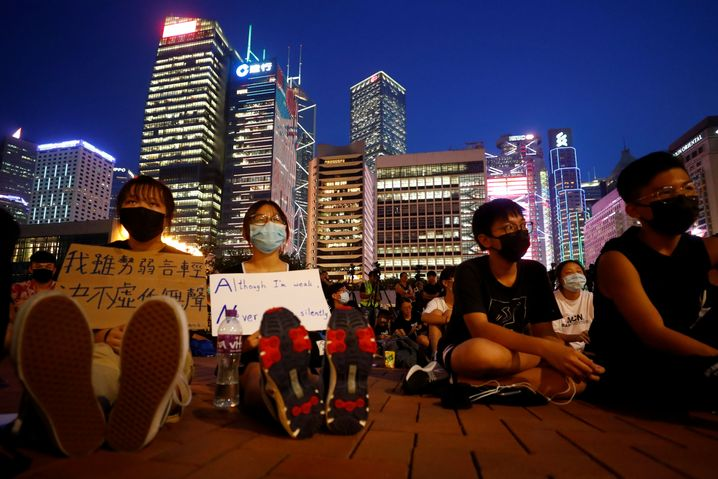 """Students attend a rally to call for political reforms outside City Hall in Hong Kong on Aug. 22: """"A certain amount of pessimism"""" has spread among residents, says a leading expert on China in Germany."""
