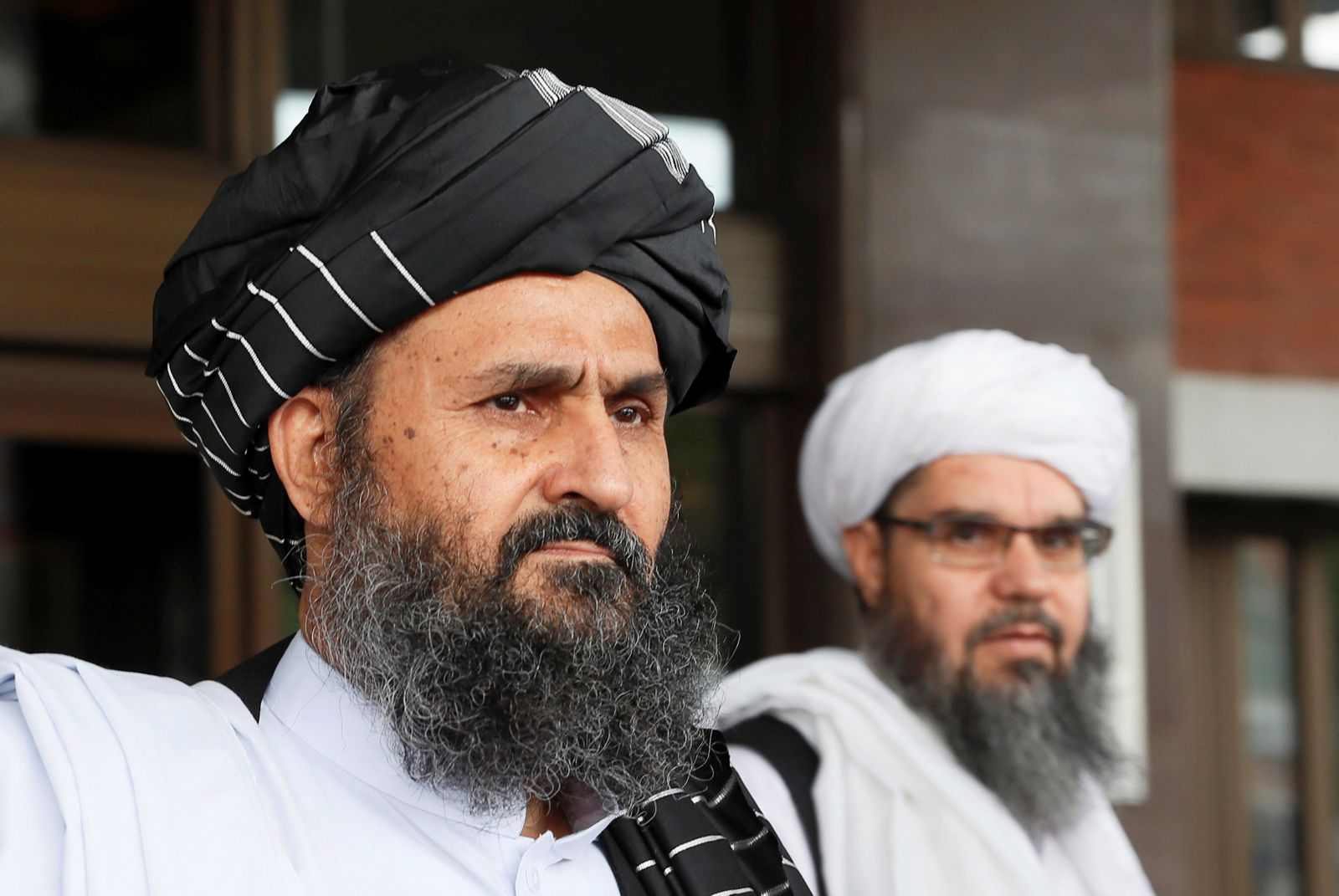 Members of a Taliban delegation leave after peace talks with Afghan senior politicians in Moscow