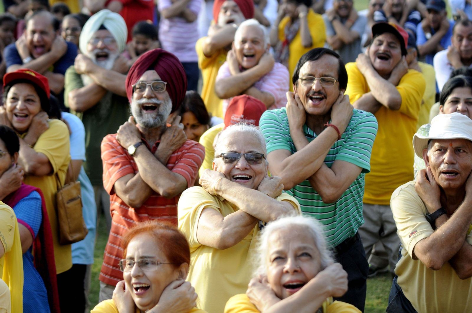 People Take Part In Laughing Yoga Session Ahead Of World Laughing Day
