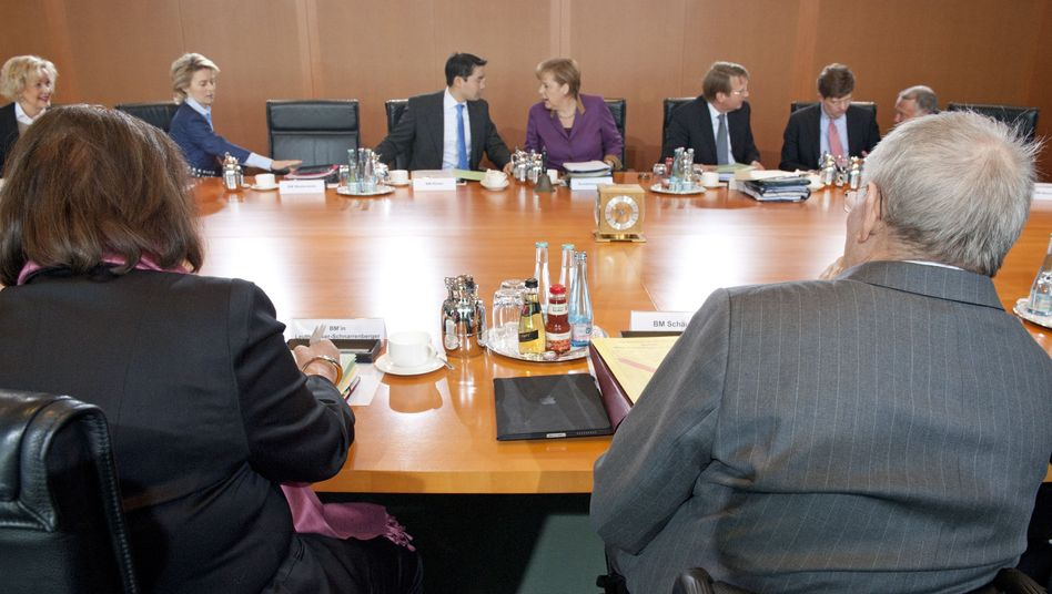Chancellor Merkel (center) at a meeting with her cabinet in Berlin: an embarrassing lapse