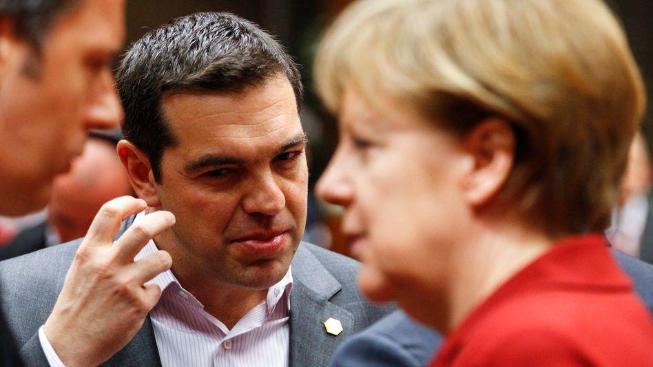 Kontrahenten Tsipras, Merkel: Endlich einen Ausweg finden