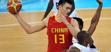 China's Yao Ming protects the ball from US superstar Kobe Bryant.