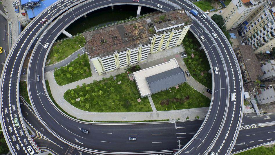 Eingekreist von der Ringstraße: Ein Apartmentgebäude in der chinesischen Stadt Guangzhou