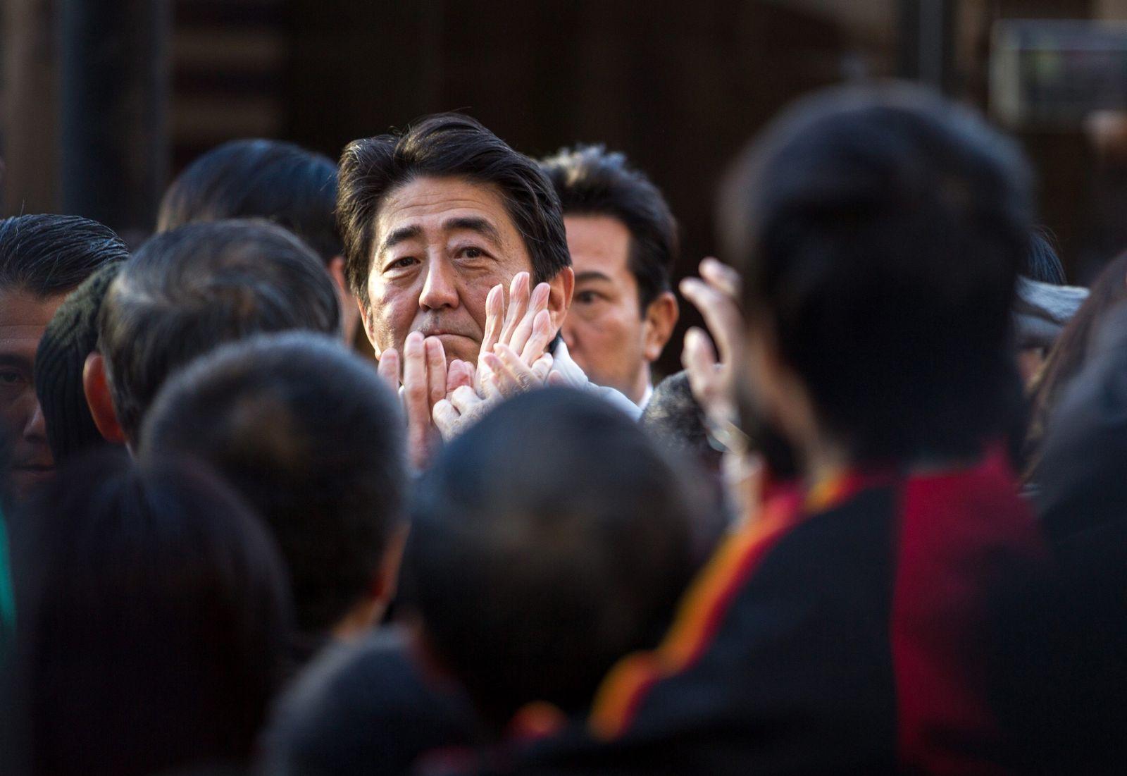 Japanese Prime Minister Shinzo Abe speaks to voters in Tokyo
