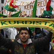 A man holds Kurdistan scarf during a demonstration in Berlin last October.