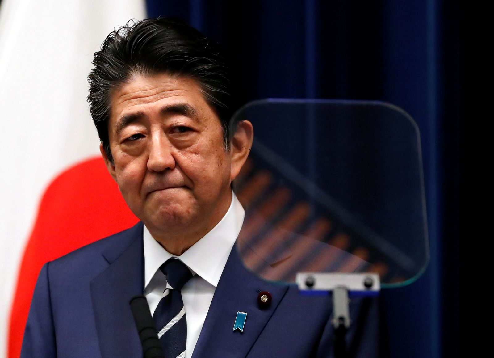 Japan's Prime Minister Shinzo Abe attends a news conference on coronavirus at his official residence in Tokyo
