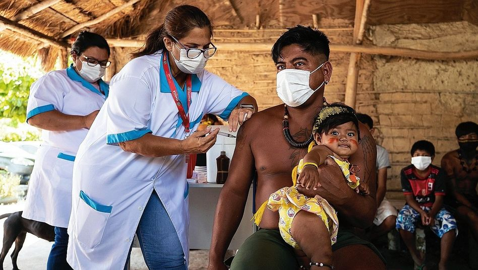 A man in Brazil being vaccinated.