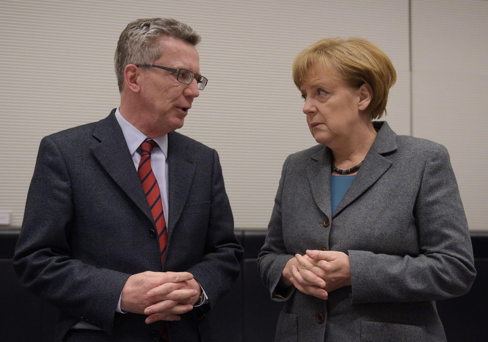 Merkel/ de Maiziere