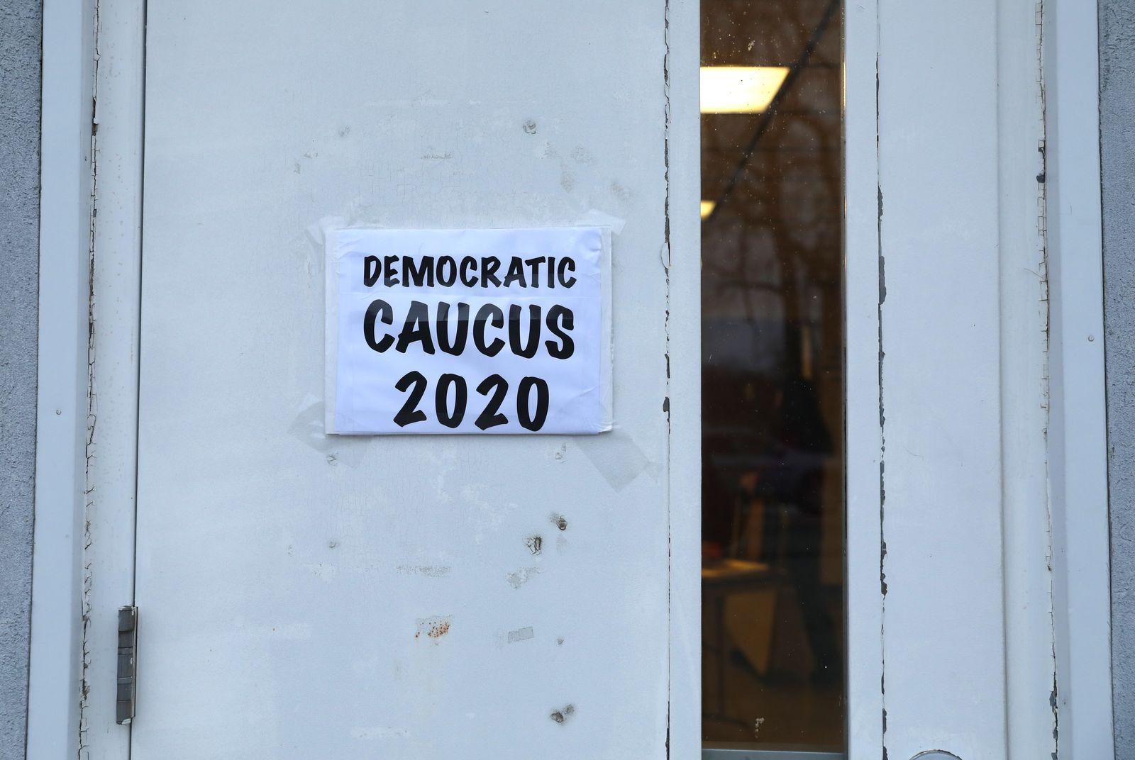 A sign is seen on a caucus doorway in Kellogg., Iowa, U.S.