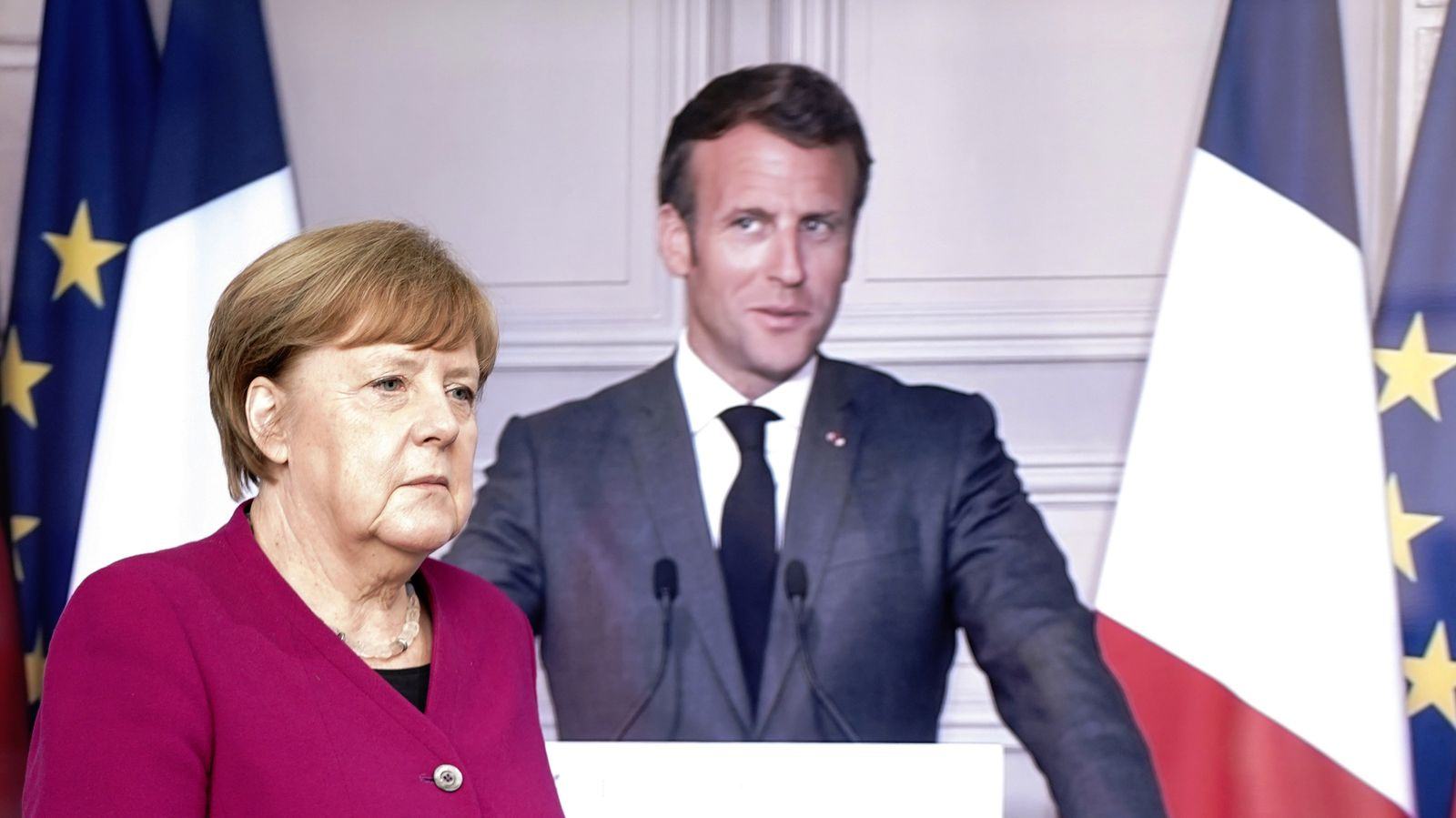 German Chancellor Angela Merkel arrives for a joint video news conference with French President Emmanuel Macron