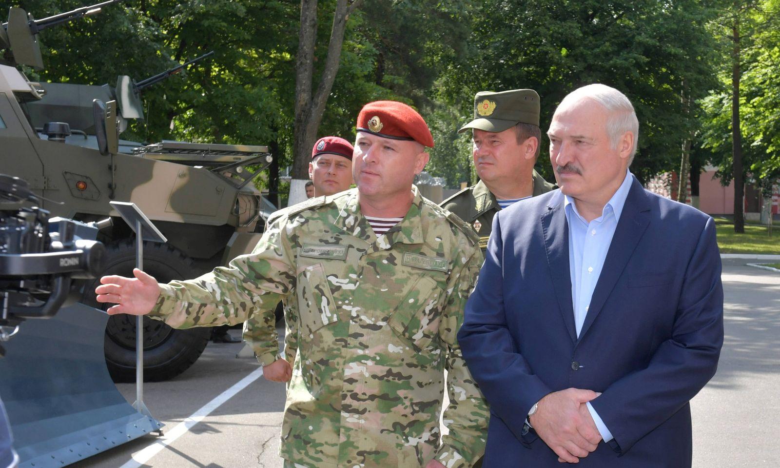 MINSK, BELARUS - JULY 28, 2020: The President of Belarus, Alexander Lukashenko (R front) visits No 3214 Unit of the Int
