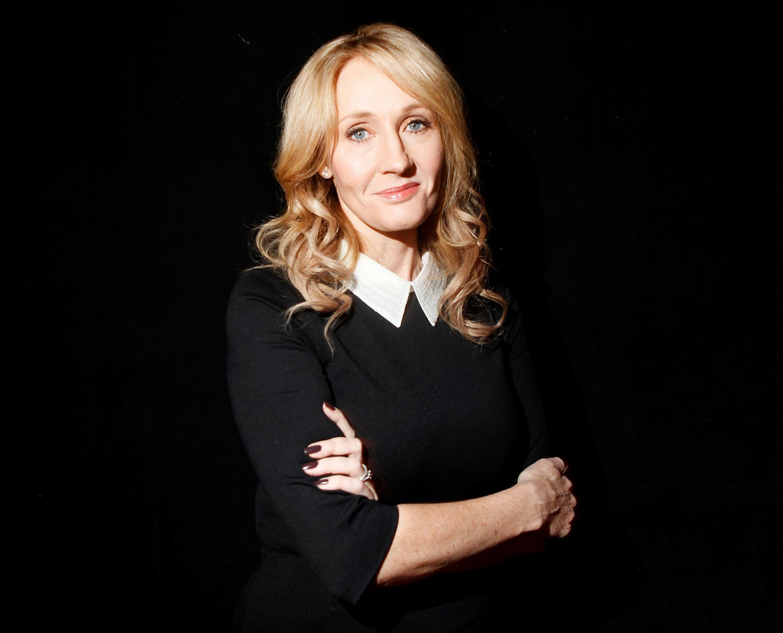 "FILE PHOTO: Author Rowling poses for a portrait while publicizing her adult fiction book ""The Casual Vacancy"" in New York"