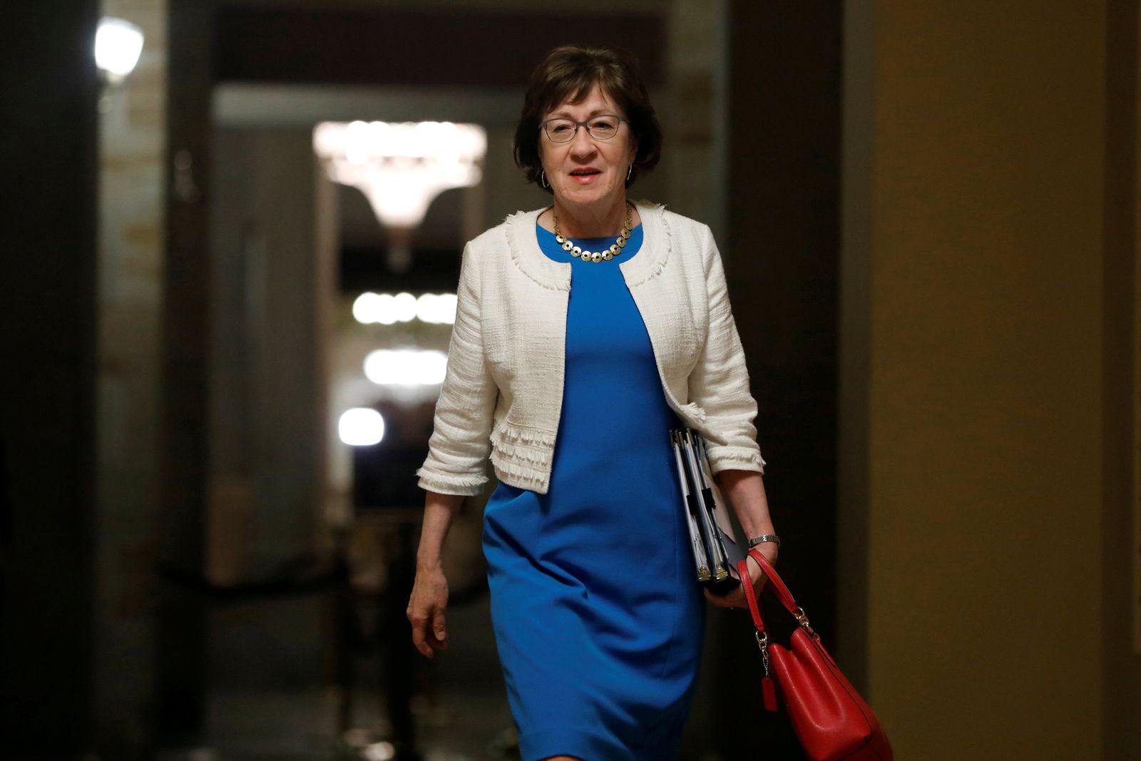 FILE PHOTO: Senator Susan Collins (R-ME) walks to the Senate floor on Capitol Hill in Washington