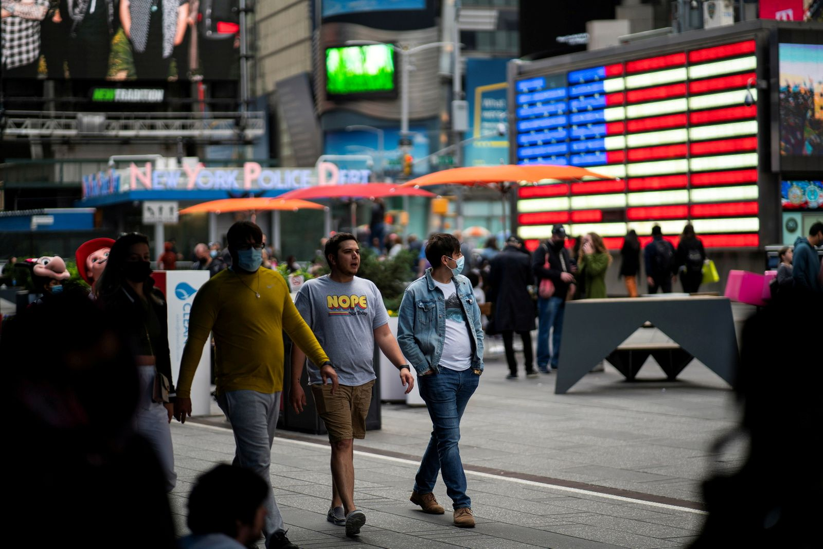 FILE PHOTO: People make their way through Times Square, amid the coronavirus disease (COVID-19) pandemic, in Manhattan, New York City