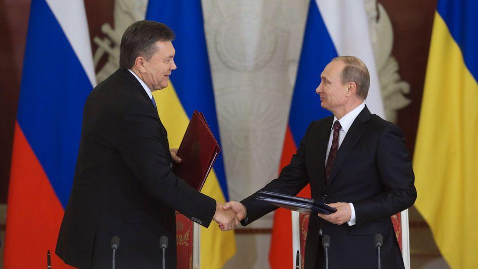 Janukowitsch und Putin: Nur noch 268,50 Dollar pro 1000 Kubikmeter Gas