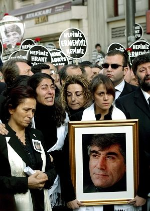 Hrant Dink's wife Rakel (left) and her daughter Sera (second left) shed tears as they follow the funeral procession for their husband and father.