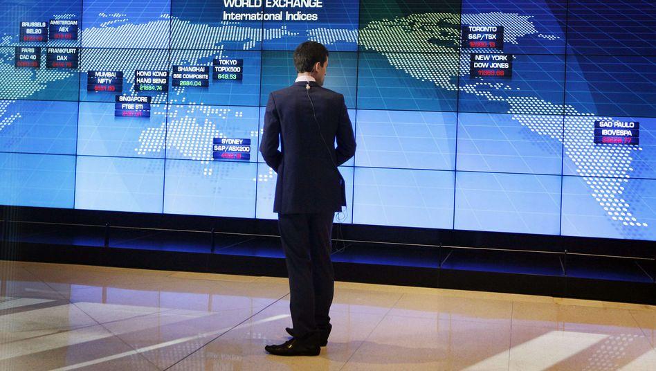 A television journalist in Australia observes tumbling market data.