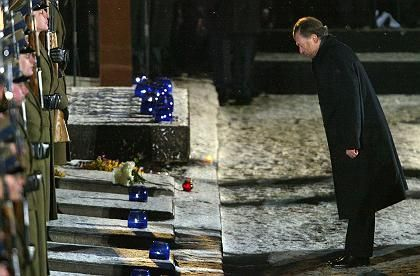 German President Horst Koehler bows in memory at Auschwitz. Do Germans belong at Holocaust memorial ceremonies?