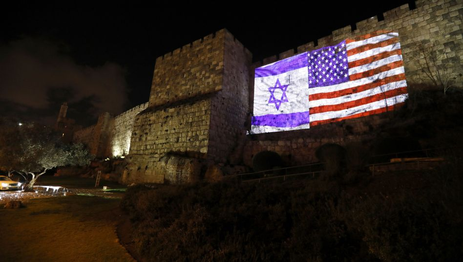 Israeli and U.S. flags projected onto the wall of Jerusalem's Old City.