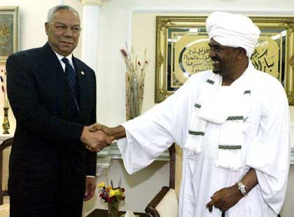 US Secretary of State Colin Powell and Sudan President Omar El-Beshir. The US helped broker the peace deal.