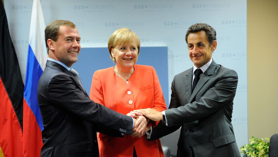 Russian president Dmitry Medvedev (left), German Chancellor Angela Merkel and French President Nicolas Sarkozy during a trilateral meeting on the sidelines of the June G-20 summit in Toronto.