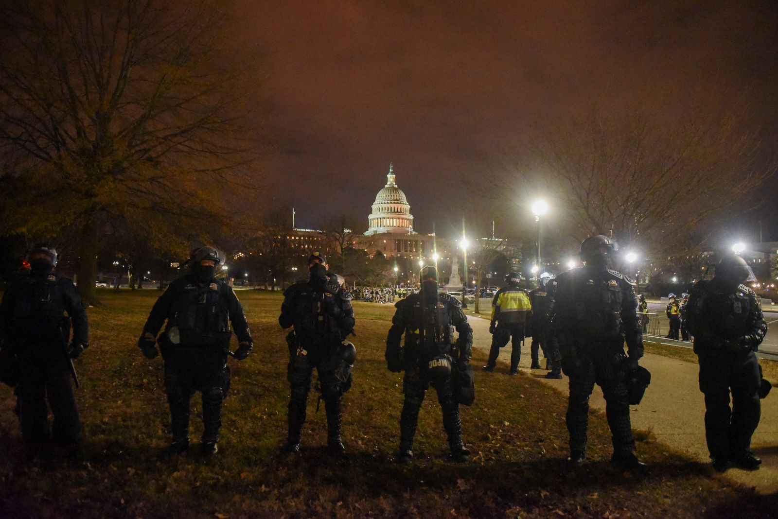 Security forces stand guard as the surroundings of the U.S. Capitol are empty during a curfew in Washington