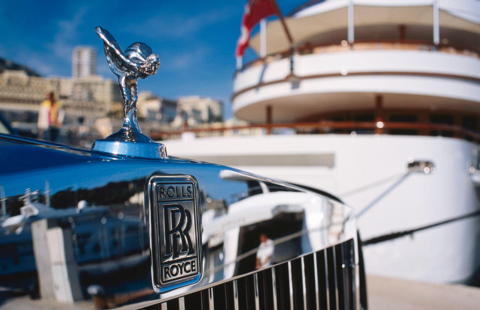 Detail of Rolls Royce parked in front of luxury yacht, Port Hercule.