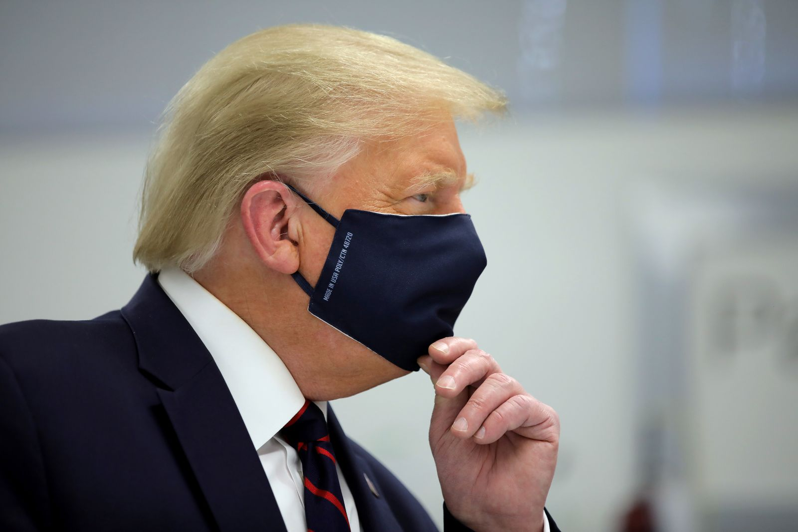 U.S. President Donald Trump wears a protective face mask during a tour of the Fujifilm Diosynth Biotechnologies' Innovation Center, in Morrisville