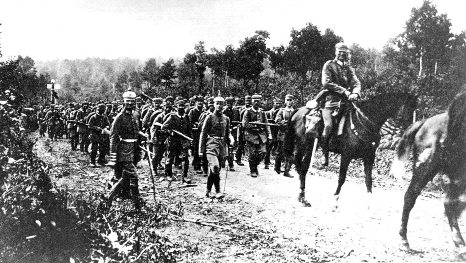 German troops advancing into France in August 1914. Germany says it isn't trying to influence the way Britain commemorates the event.
