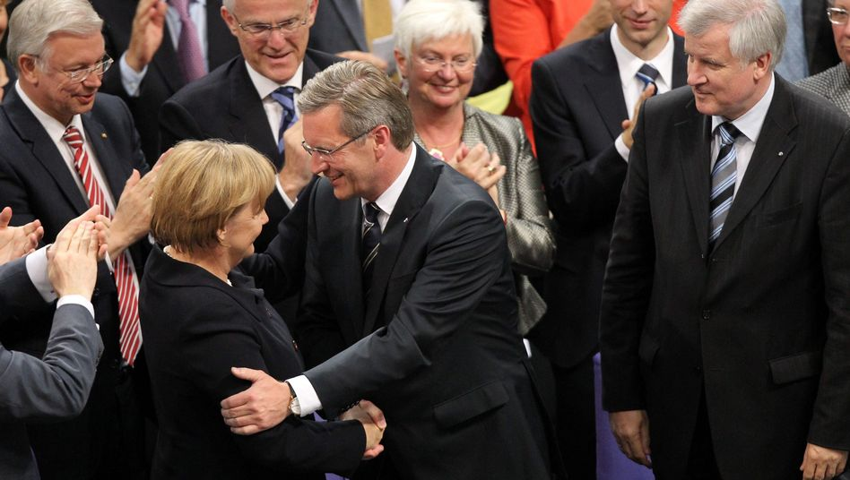 Christian Wulff (c) with Angela Merkel after being elected German president.