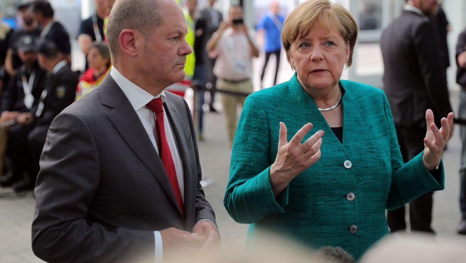 Bundeskanzlerin Angela Merkel (CDU) und Hamburgs Erster Bürgermeister Olaf Scholz (SPD)