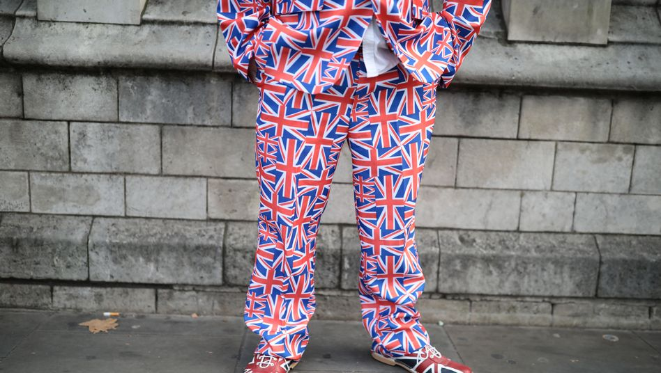 A man dressed in a Union Jack suit outside Westminster in London