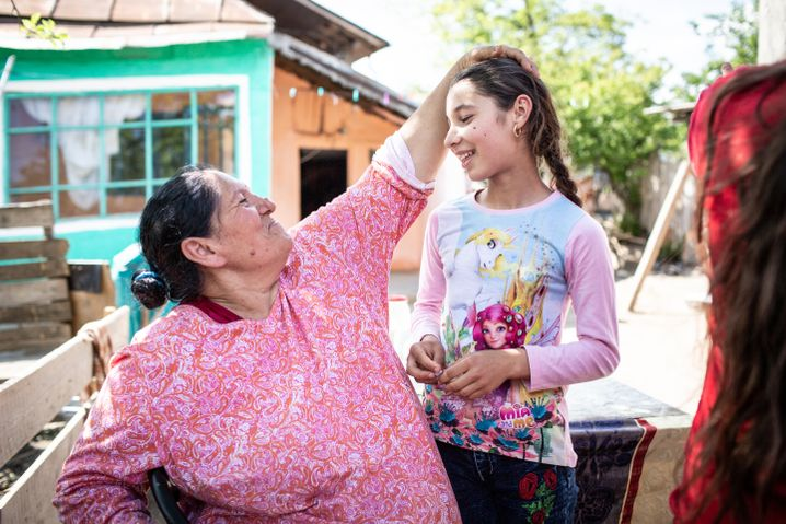 Petronela and her grandmother in the village of Bacioi.