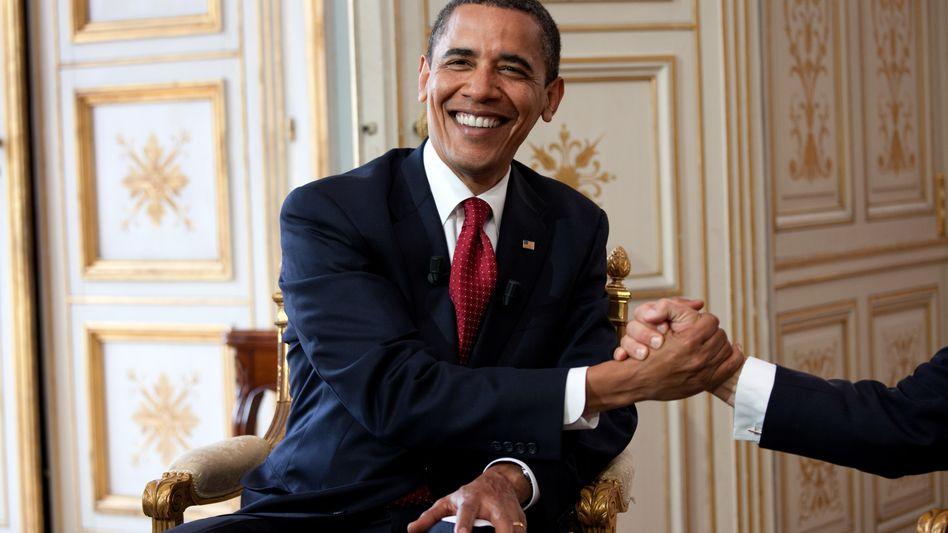 Handschlag zwischen Obama und Sarkozy (verdeckt): Der Zauber der Bilder zählt