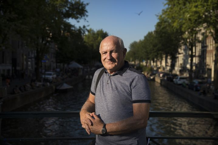"""Stephen Hodes at one of the canals in Amsterdam's historic center: """"There is a lot of fear that the city will become an amusement park and the last residents will disappear."""""""