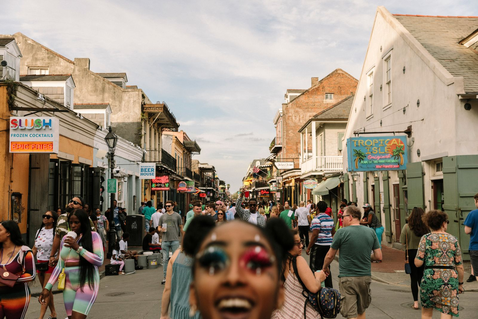 People walk through Bourbon Street in New Orleans, March 15, 2020. (William Widmer/The New York Times)