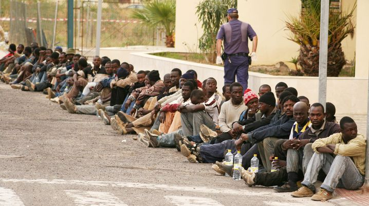 Africans have been detained after scaling a barrier separating Spain's North African enclave of Melilla from Morocco.