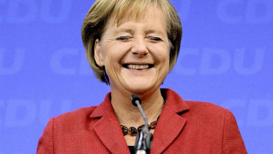 """German Chancellor Angela Merkel secured a second term in office following Sunday's vote: """"I am happy to have achieved a great thing."""""""