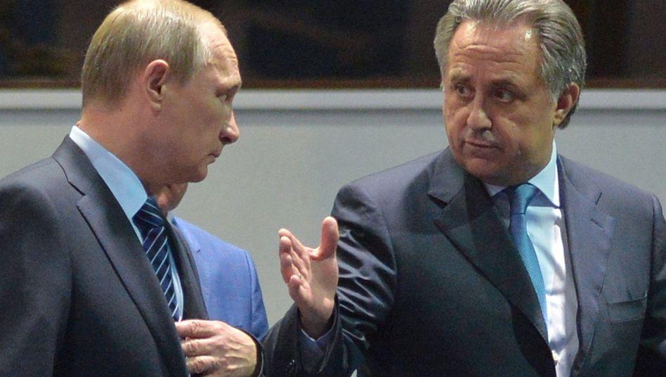 Wladimir Putin (l.) und Sportminister Witali Mutko