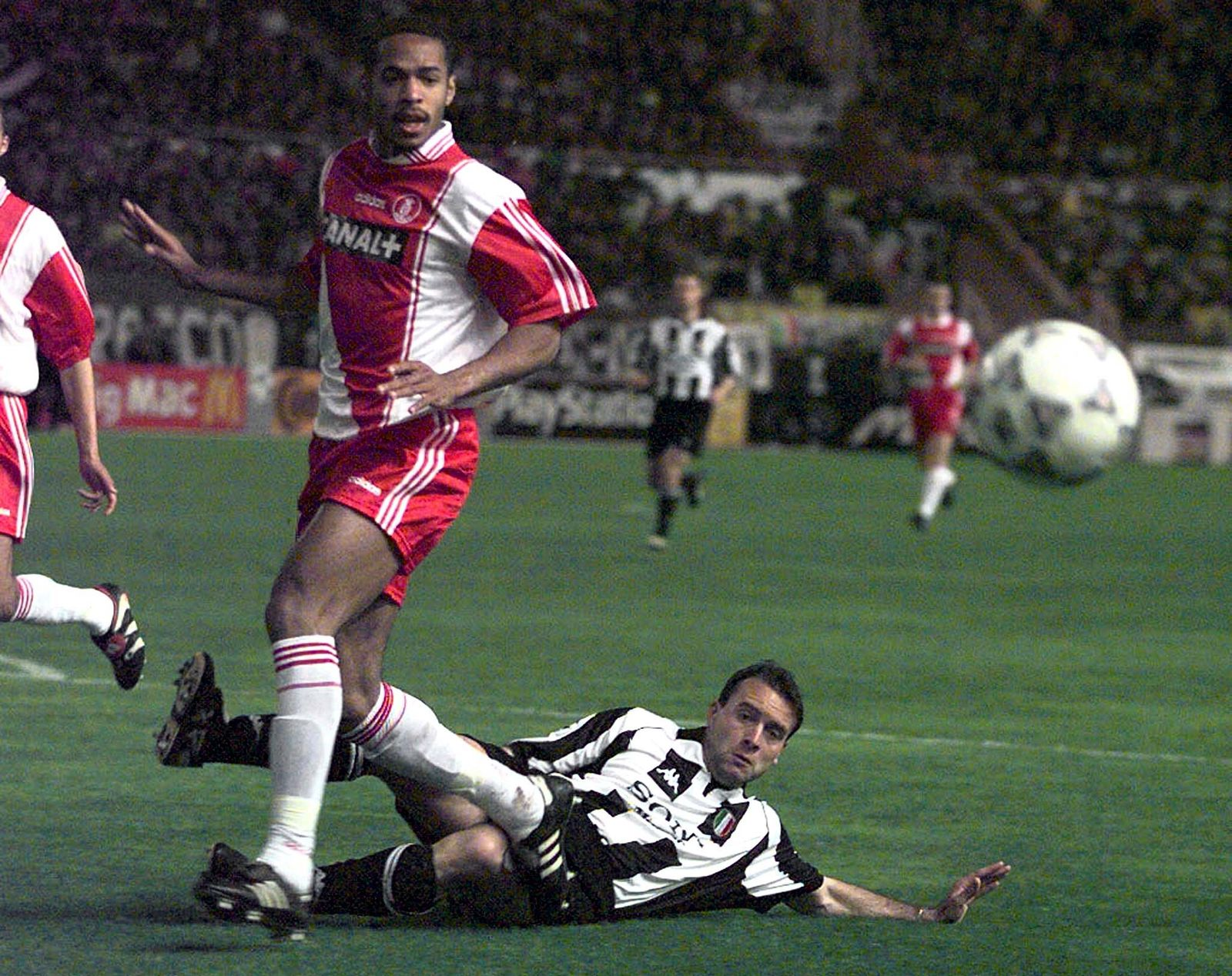 HENRY OF MONACO IS TACKLED BY BIRINDELLI OF JUVENTUS.